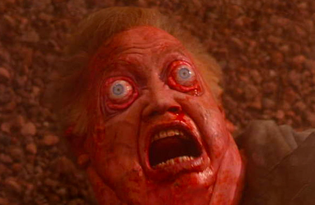 Vilos Cohaagen in the original Total Recall, with a bloated, bloody face and bulging eyes, as he experiences decompression.