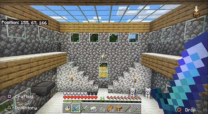 Interior of a building in Minecraft with a large skylight and stairs leading up to two balconies.