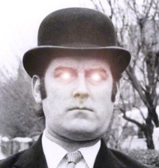 John Cleese with glowing eyes
